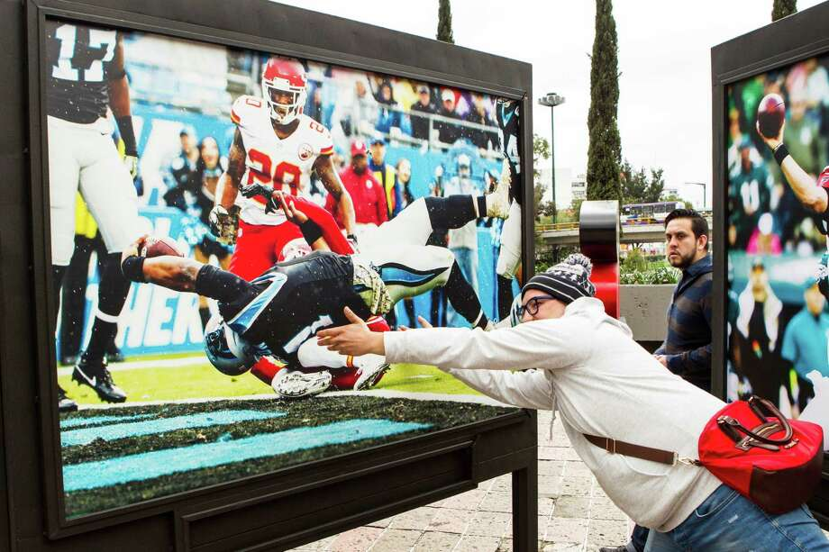 Raiders fan Yael Otamendi tries to get in on the action at the NFL Fan Fest on Saturday at Chapultepec Park in Mexico City. The Texans play the Raiders on Monday. Photo: Brett Coomer, Staff / © 2016 Houston Chronicle