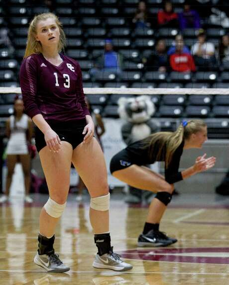 Clear Creek's Caitlyn Burroway (13) looks at the scoreboard as Hebron's Lexie Douglas celebrates a point in the Class 6A state final Saturday in Garland. Photo: Jason Fochtman, Staff Photographer / Houston Chronicle