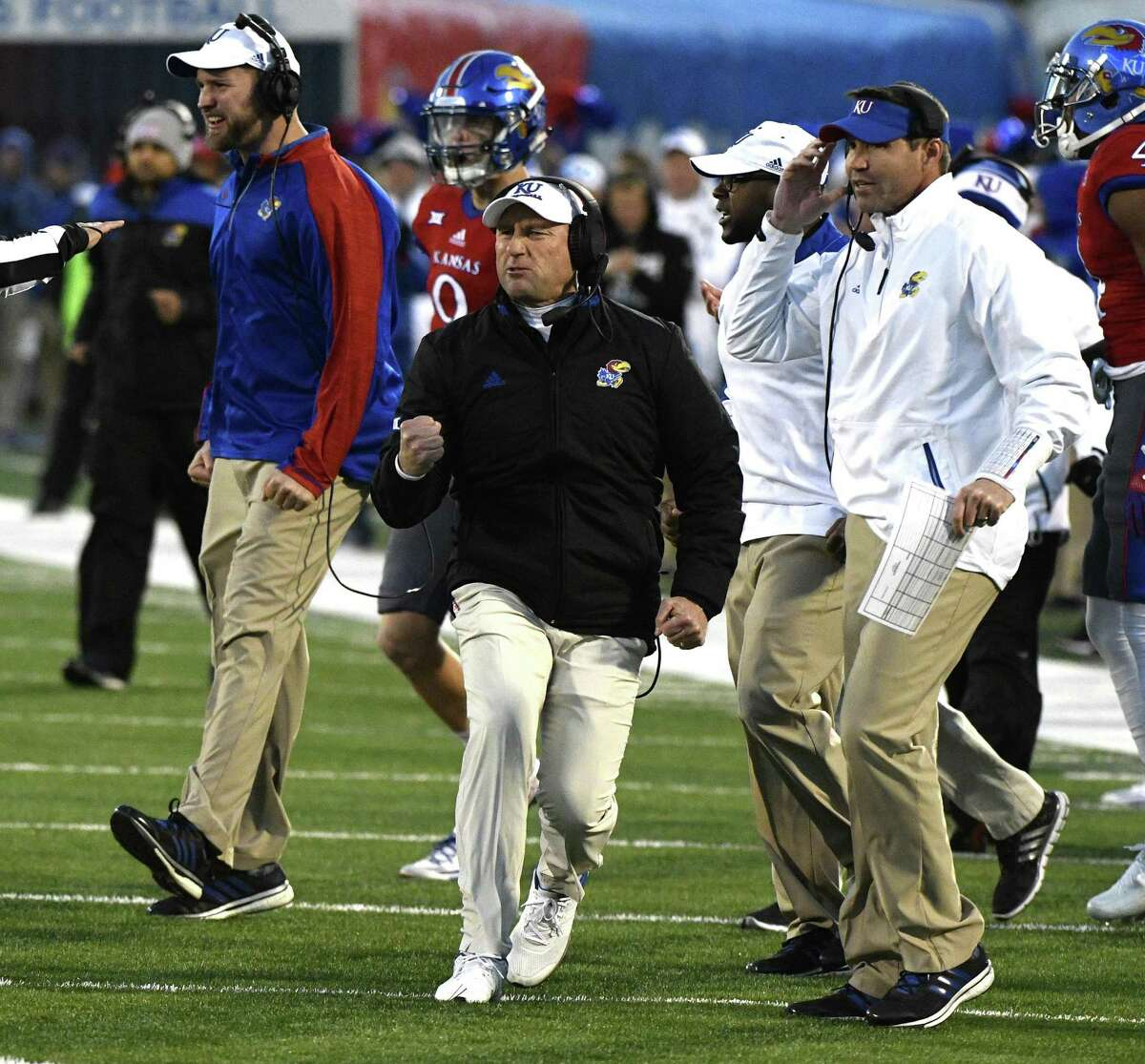 LAWRENCE, KS - NOVEMBER 19: David Beaty (C) head coach of the Kansas Jayhawks celebrates after the Texas Longhorns missed a field goal in the third quarter at Memorial Stadium on November 19, 2016 in Lawrence, Kansas. Kansas won 24-21 in overtime. (Photo by Ed Zurga/Getty Images)