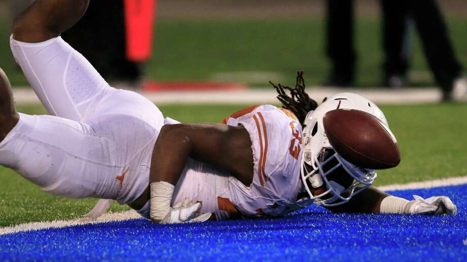 Texas running back D'Onta Foreman (33) lands in the end zone after being ruled down on the one-yard-line during the second half of an NCAA college football game against Kansas in Lawrence, Kan., Saturday, Nov. 19, 2016. Foreman scored a touchdown on the next play. (AP Photo/Orlin Wagner) Photo: Orlin Wagner, STF / Copyright 2016 The Associated Press. All rights reserved.