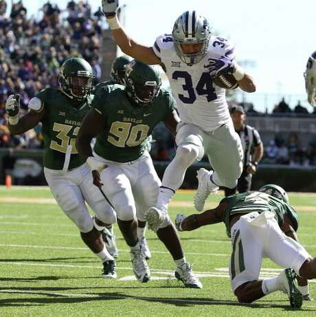Kansas State running back Alex Barnes (34) scores past Baylor cornerback Grayland Arnold, right, and defensive end Tyrone Hunt (90), in the second half of an NCAA college football game, Saturday, Nov. 19, 2016, in Waco, Texas. (Jerry Larson/Waco Tribune Herald via AP) Photo: Jerry Larson, MBO / Waco Tribune-Herald