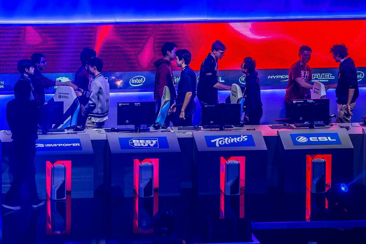 Stanford and UC Berkeley students shake hands, following a League of Legends match during the Intel Extreme Masters at the Oracle Arena on Saturday, Nov. 19, 2016 in Oakland, Calif. Stanford won the game.