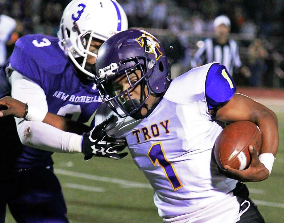 Troy's #1 Joey Ward breaks away from New Rochelle's  #3 Myles Taylor during their Class AA state semifinal game at Dietz Stadium Saturday Nov. 19, 2016 in Kingston, NY.  (John Carl D'Annibale / Times Union) Photo: John Carl D'Annibale / 20038815A