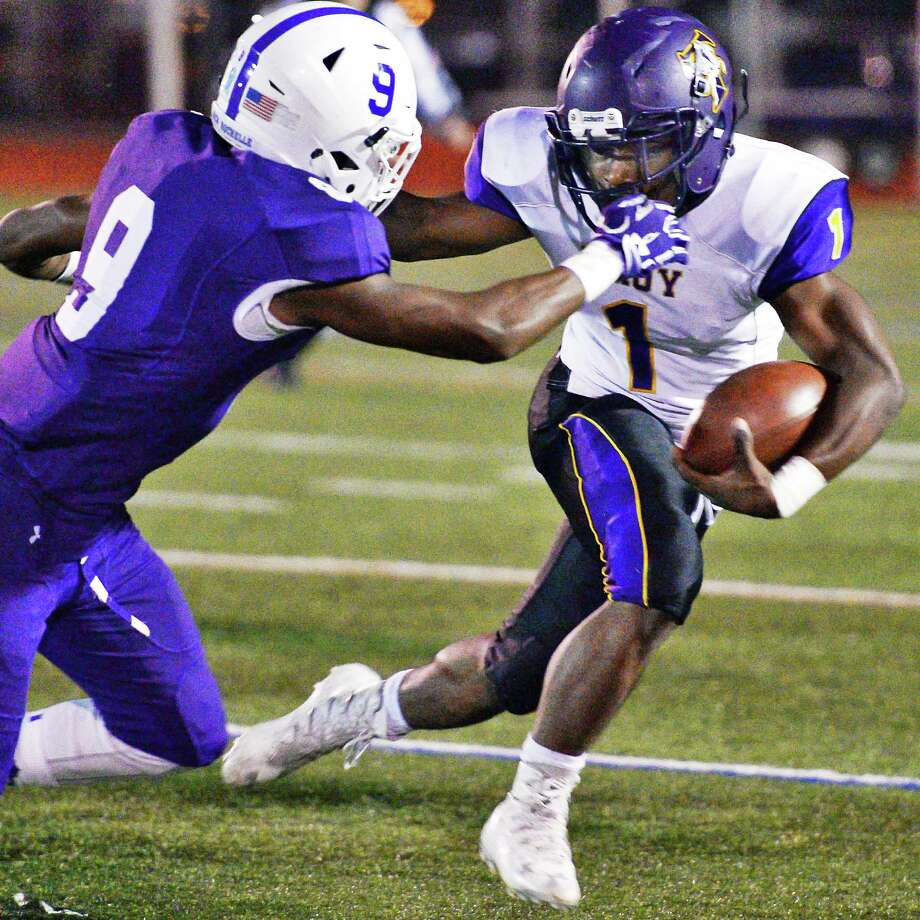 Troy's #1 Joey Ward, left, blasts by New Rochelle defender #9 Nashiem Hiland during their Class AA state semifinal game at Dietz Stadium Saturday Nov. 19, 2016 in Kingston, NY.  (John Carl D'Annibale / Times Union) Photo: John Carl D'Annibale / 20038815A