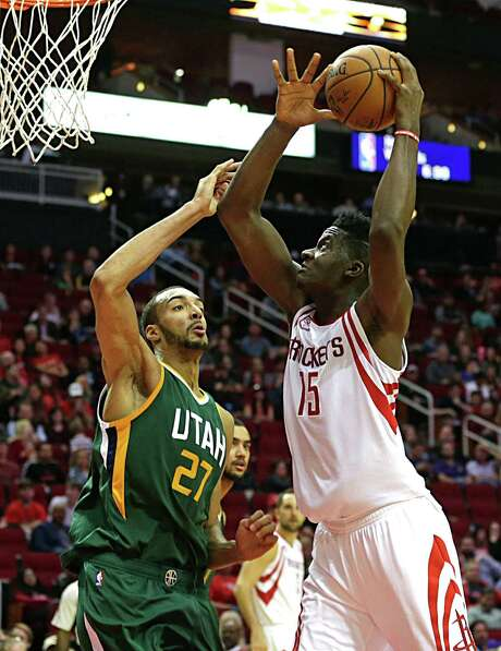 The Rockets' Clint Capela right, shoots over Jazz center Rudy Gobert during the Rockets' win. Capela looked up to Gobert early in their careers. Photo: James Nielsen, Staff / © 2016  Houston Chronicle