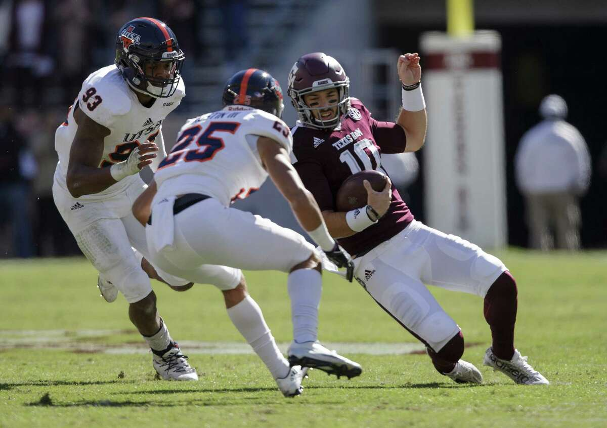Texas A&M quarterback Jake Hubenak (10) slides before being hit by UTSA safety Carl Austin III (25) during the first quarter of an NCAA college football game Saturday, Nov. 19, 2016, in College Station, Texas. Austin was ejected on the play for a targeting call. (AP Photo/Sam Craft)