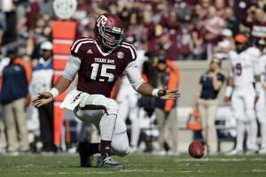 Texas A&M defensive lineman Myles Garrett (15) reacts after knocking down a pass against UTSA during the third quarter of an NCAA college football game Saturday, Nov. 19, 2016, in College Station, Texas. (AP Photo/Sam Craft)