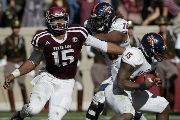 Texas A&M defensive lineman Myles Garrett (15) makes a one-handed sack as he pulls down UTSA quarterback Jared Johnson (15) during the third quarter of an NCAA college football game Saturday, Nov. 19, 2016, in College Station, Texas. (AP Photo/Sam Craft)