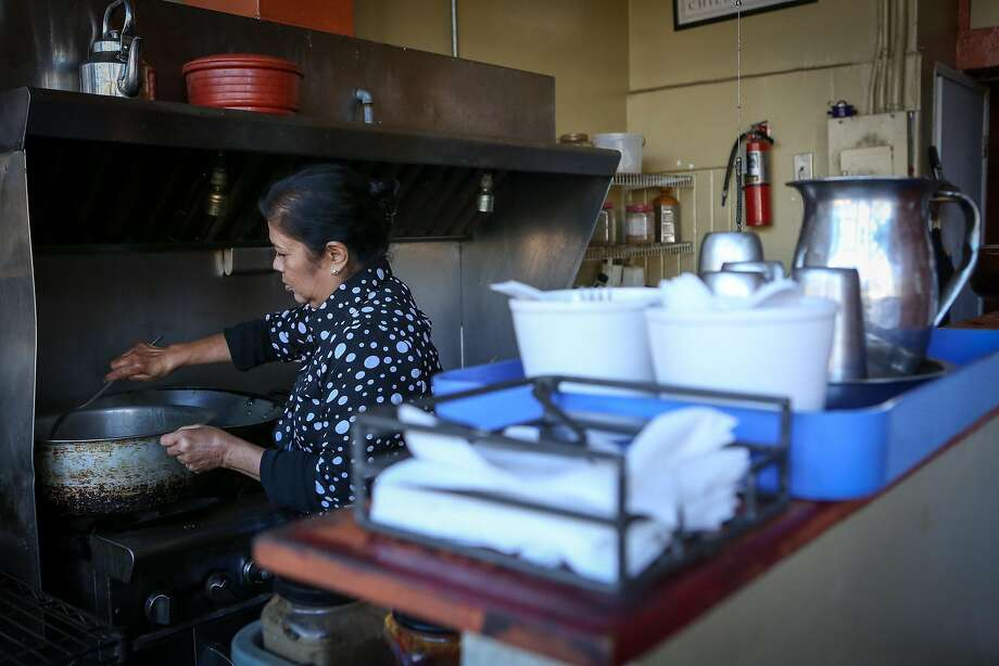 Saras Rao, chef and owner of Curry Corner in Hayward, stirs a pot of curry. Photo: Amy Osborne, Special To The Chronicle