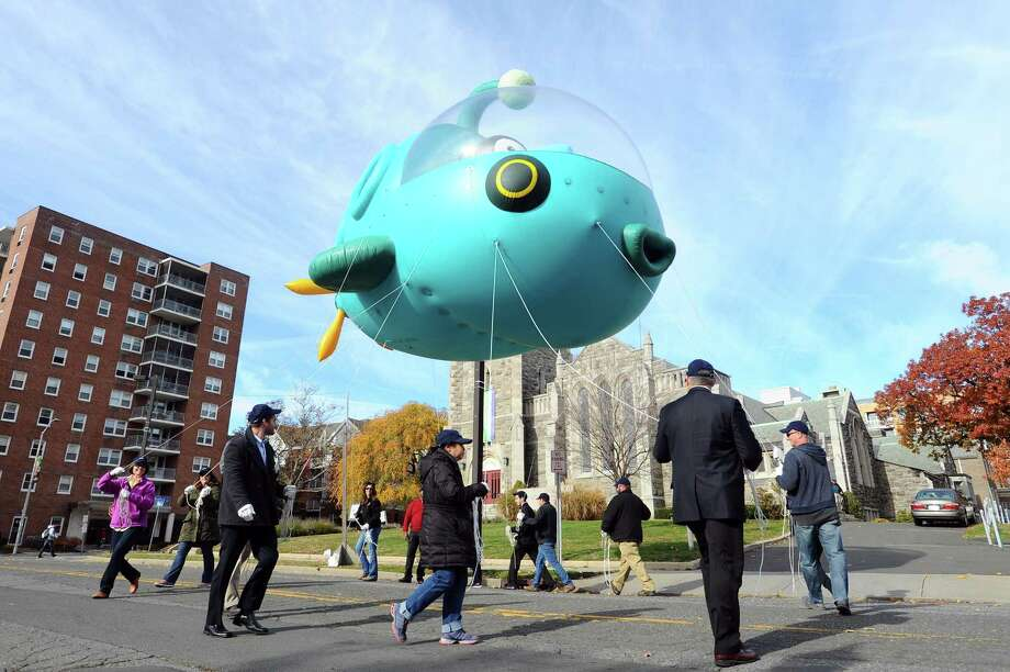 Volunteers practice walking with a new balloon featuring the Octonauts following a press conference about the upcoming UBS Parade Spectacular on Forest St. in downtown Stamford, Conn. on Thursday, Nov. 10, 2016. Photo: Michael Cummo / Hearst Connecticut Media / Stamford Advocate