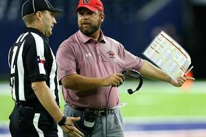 Westfield football coach Matt Meekins argues a call during a Class 6A game last fall. A dispute with a coach is one of the least-attractive aspects of officiating a high school game.
