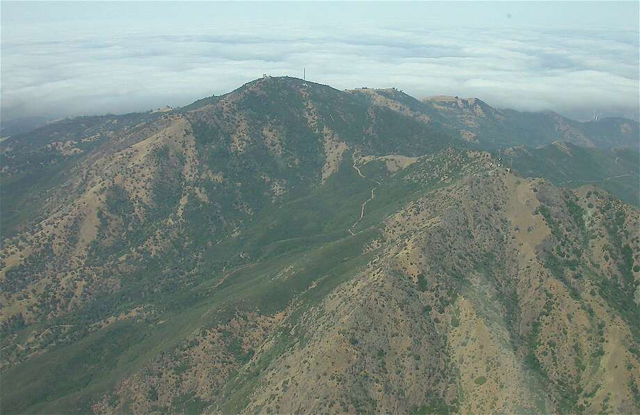 3,849-foot Mount Diablo viewed from pilot's seat from airplane. Mount Diablo State Park is one of 24 of 28 state parks taking part in free access available on Green Friday that has sold out. Photo: Tom Stienstra, Tom Stienstra / The Chronicle