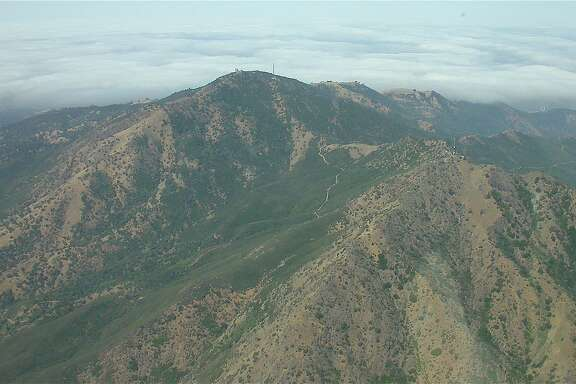 3,849-foot Mount Diablo viewed from pilot's seat from airplane. Mount Diablo State Park is one of 24 of 28 state parks taking part in free access available on Green Friday that has sold out.
