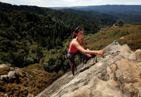 Holly Tate, of Santa Cruz climbs Goat Rock, a popular climbing spot at Castle Rock State Park on Wednesday August 17, 2011, in Los Gatos, Ca. Castle Rock is one of the Bay Area parks currently on the closure list which may close down due to California budget cuts.
