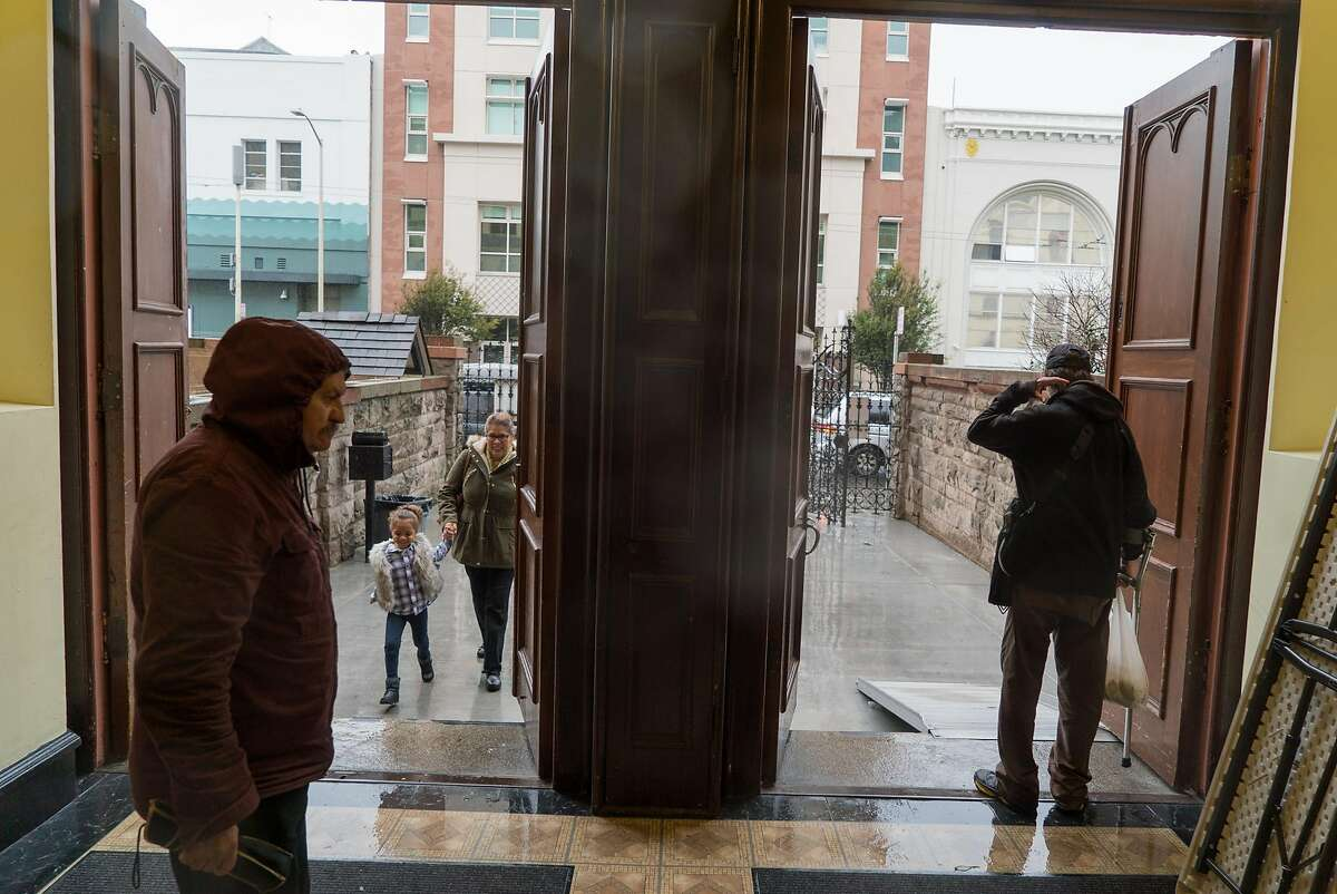 People walk in and out of St. Boniface Church in San Francisco, Calif. on Sunday, Nov. 20, 2016. The church will be opening it's doors for extended hours during the winter.