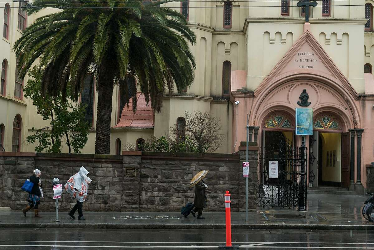 People walk past St. Boniface Church in San Francisco, Calif. on Sunday, Nov. 20, 2016. The church will be opening it's doors for extended hours during the winter.