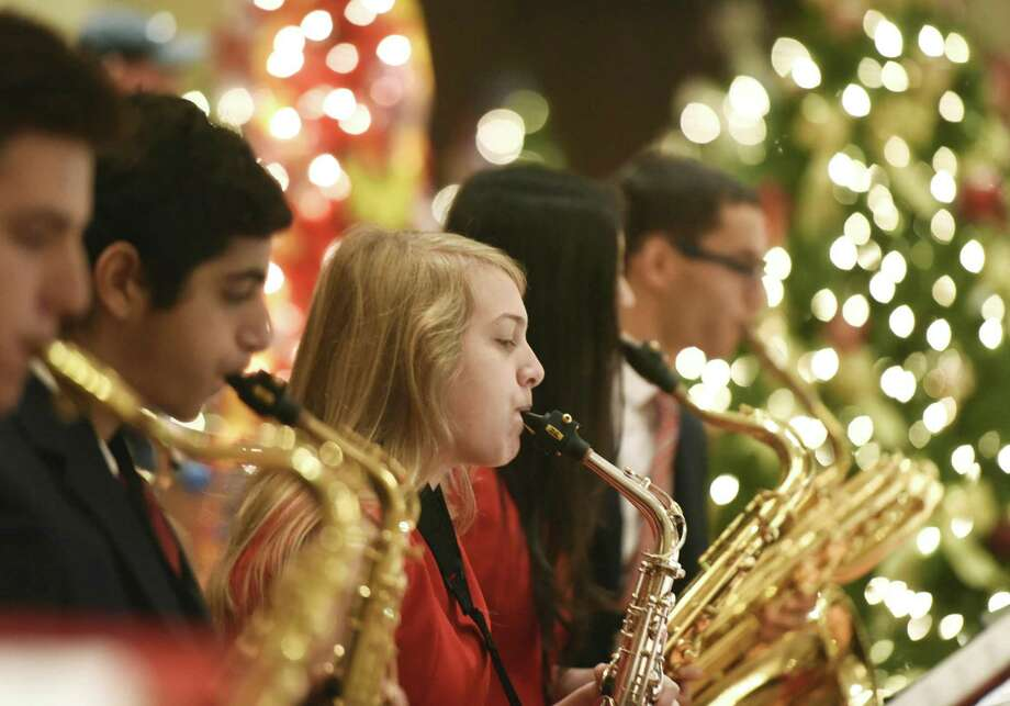Greenwich High School junior Jillian Olesen plays the saxophone with the GHS Jazz Ensemble during the Junior League of Greenwich's Enchanted Forest holiday program at the Hyatt Regency in Old Greenwich, Conn. Sunday, Nov. 20, 2016. The event, now in its 40th year, featured 50 craft and specialty boutiques, a kids gingerbread village, musical performances, photo ops with Santa and an enchanted forest of trees decorated by local florists, individuals and small businesses. Photo: Tyler Sizemore / Hearst Connecticut Media / Greenwich Time