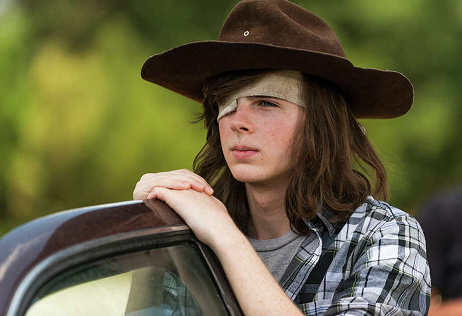 Chandler Riggs, The Walking Dead | Photo Credits: Gene Page/AMC / © 2016 AMC Film Holdings LLC. All Rights Reserved.