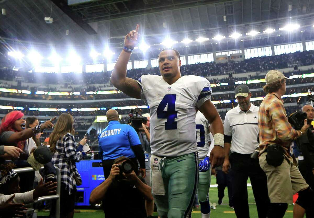 Dallas Cowboys quarterback Dak Prescott (4) acknowledges fans as he walks off the field after their NFL football game against the Baltimore Ravens on Sunday, Nov. 20, 2016, in Arlington, Texas. (AP Photo/Ron Jenkins)
