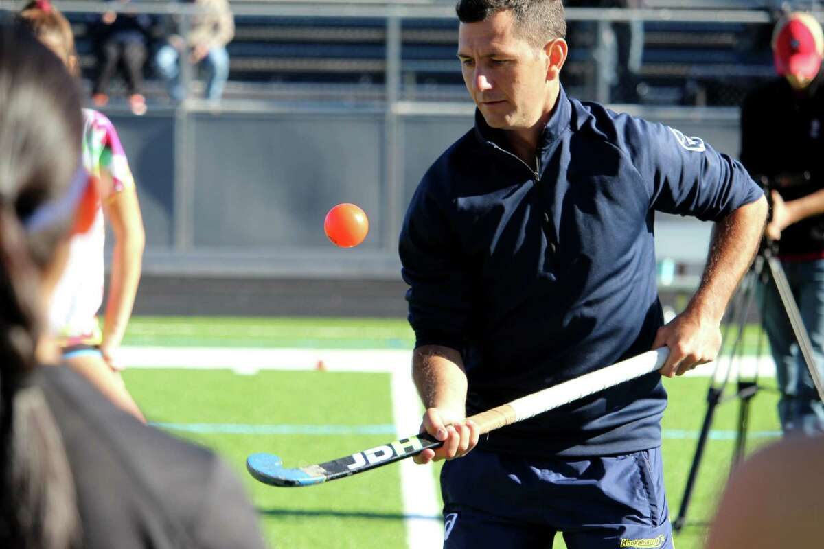Five-time World Hockey Player of the Year Jamie Dwyer demonstrates the around the world trick at one of his field hockey clinics on Saturday, Nov. 19.