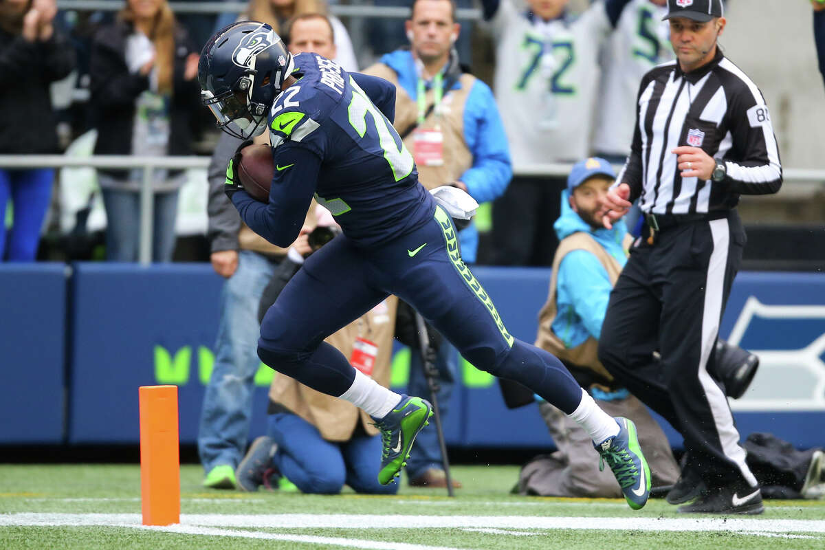 Seahawks running back C.J. Prosise runs scores a touchdown in the first half of a football game against the Philadelphia Eagles at CenturyLink Field on Sunday, Nov. 20, 2016.
