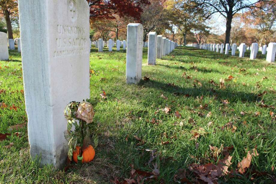 In this Nov. 11, 2016 photo, a gravestone, left, with the inscription UNKNOWN U.S. SAILOR, is adorned with a flower and a small pumpkin at Long Island National Cemetery in Farmingdale, N.Y. A WWII researcher says he has documents showing the grave is one of four that each holds the body of a sailor who perished on Jan. 3, 1944, when their ship, the USS Turner, exploded and sank at the entrance to New York Harbor. That researcher believes many more victims of the disaster were buried in the graves together. The Pentagon still lists 136 sailors from the disaster as missing. (AP Photo/Frank Eltman) Photo: Frank Eltman, STF / Copyright 2016 The Associated Press. All rights reserved.