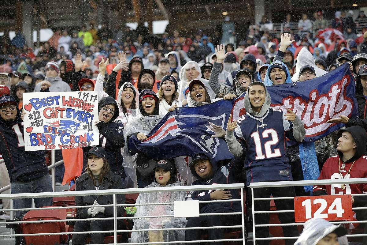 New England Patriots fans cheer during the second half of an NFL football game between the San Francisco 49ers and the Patriots in Santa Clara, Calif., Sunday, Nov. 20, 2016. (AP Photo/Marcio Jose Sanchez)