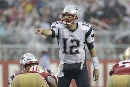 New England Patriots quarterback Tom Brady (12) signals at the line of scrimmage during the second half of an NFL football game against the San Francisco 49ers in Santa Clara, Calif., Sunday, Nov. 20, 2016. (AP Photo/Marcio Jose Sanchez)