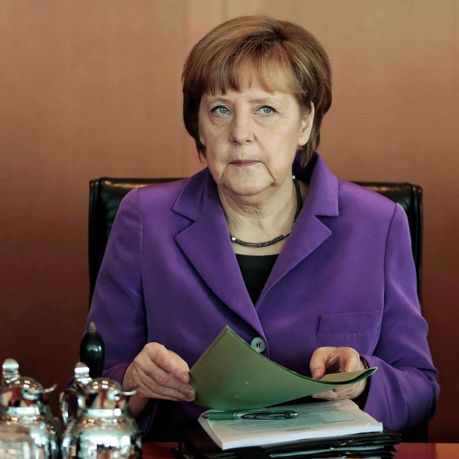 FILE---In this April 2, 2014 file photo, German Chancellor Angela Merkel attends the weekly cabinet meeting at the chancellery in Berlin. (AP Photo/Markus Schreiber,file) Photo: Markus Schreiber, STF / AP2014