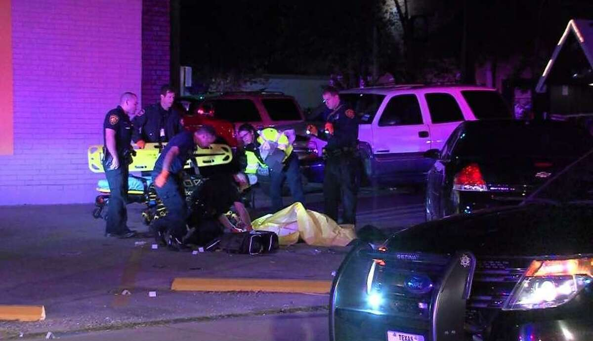 Emergency personnel work with a victim early Sunday morning, Nov. 20, 2016 in the 800 block of San Pedro Ave. Police said three people were shot, one fatally, after a fight inside a nearby bar spilled into a parking lot. Suspects are still being sought according to police.