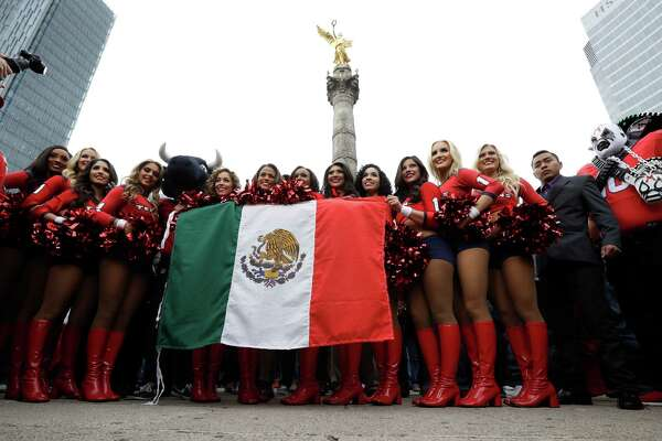Houston Texans cheerleaders perform in front of the Angel of Independence monument Sunday, Nov. 20, 2016, in Mexico City. The Texans face the Oakland Raiders in an NFL football game in Mexico City Nov. 21. (AP Photo/Gregory Bull)