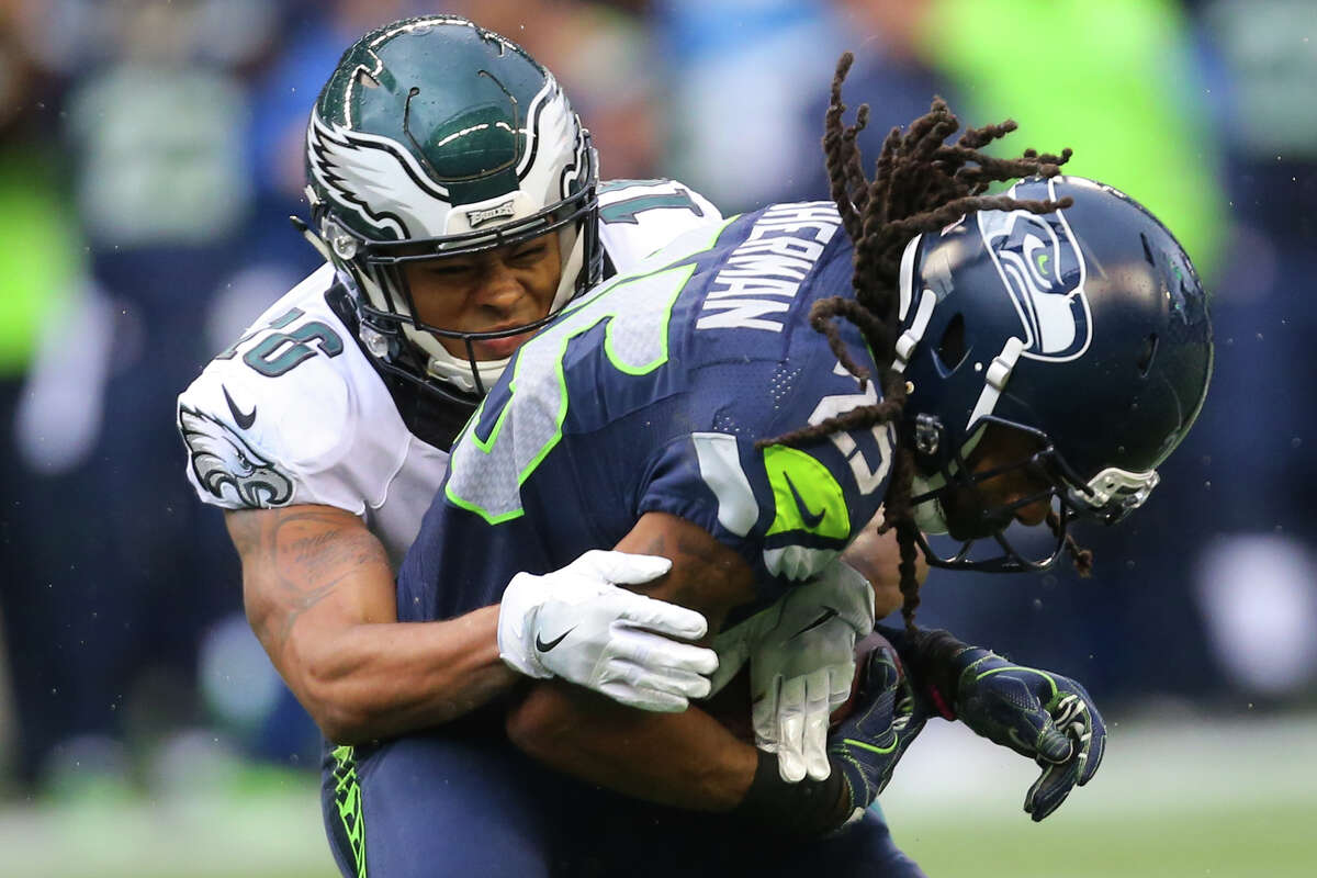 Seahawks corner back Richard Sherman comes down with an interception meant for Eagles wide receiver Bryce Treggs in the second half at CenturyLink Field on Sunday, Nov. 20, 2016.