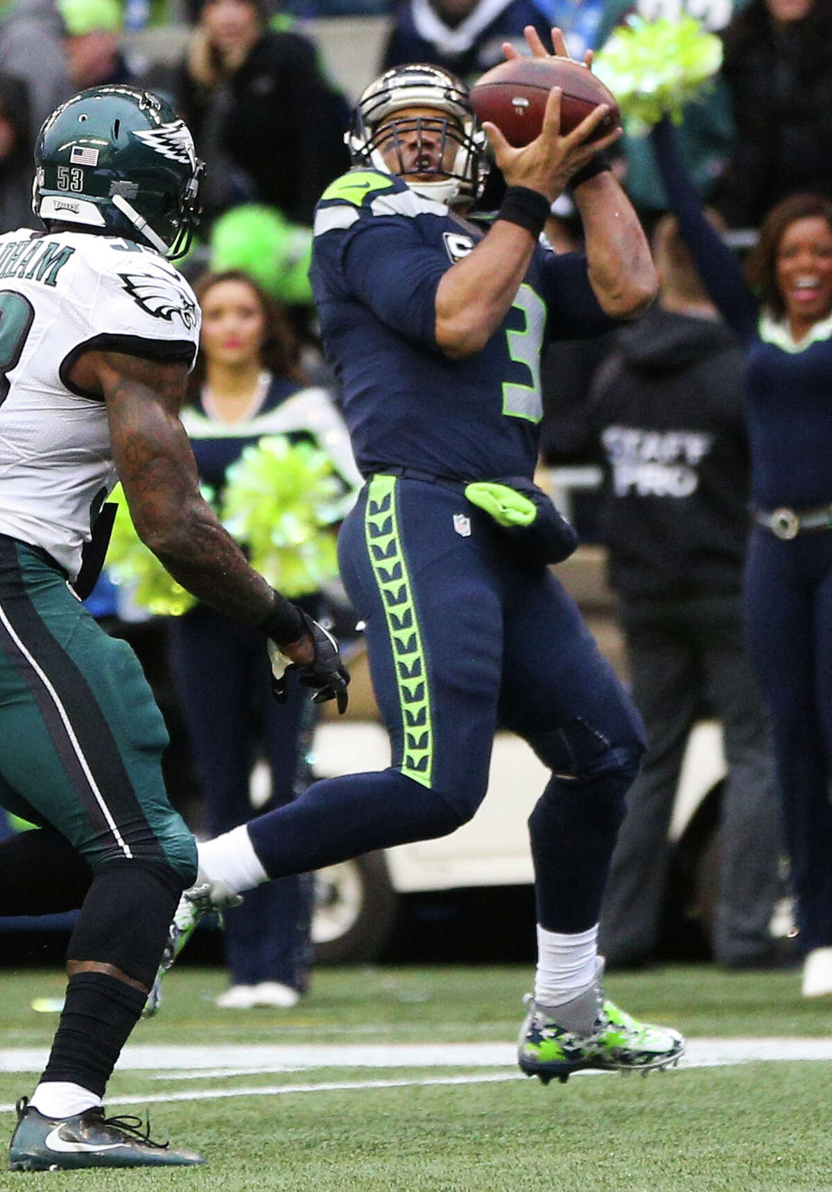 Seahawks quarterback Russell Wilson makes a catch for a touchdown in the second half of a football game against the Philadelphia Eagles at CenturyLink Field, Nov. 20, 2016.