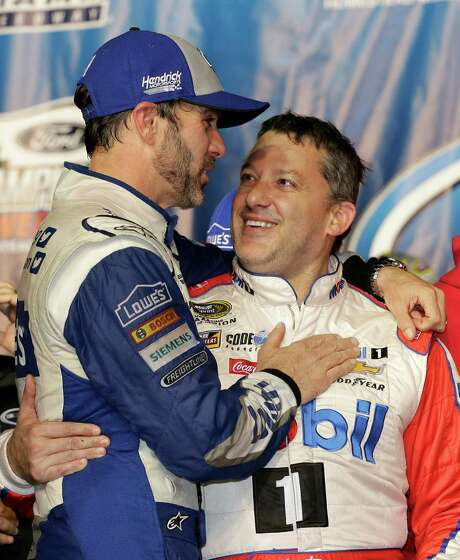 A retiring Tony Stewart,  right, gets a hug from race winner Jimmie Johnson. Photo: Terry Renna, FRE / FR60642