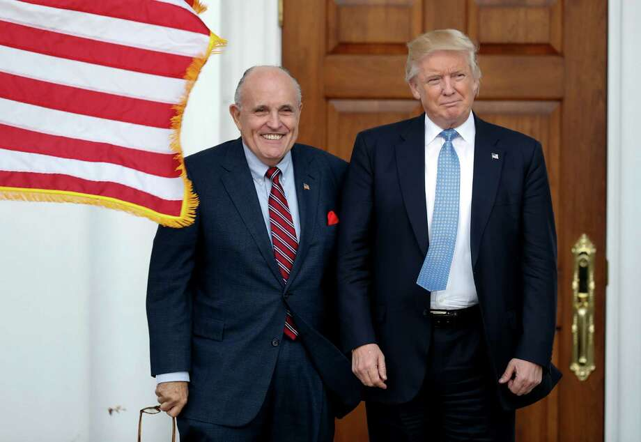 FILE-- President Donald Trump, right, and former New York Mayor Rudy Giuliani pose for photographs as Giuliani arrives at the Trump National Golf Club Bedminster clubhouse, Sunday, Nov. 20, 2016, in Bedminster, N.J. Photo: Carolyn Kaster / Copyright 2016 The Associated Press. All rights reserved.