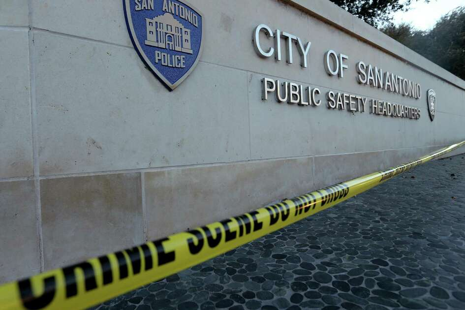 Crime scene tape outside San Antonio Police Department headquarters near the scene where SAPD Det. Benjamin Marconi was shot and killed while performing a routine traffic stop Sunday Nov. 20, 2016.