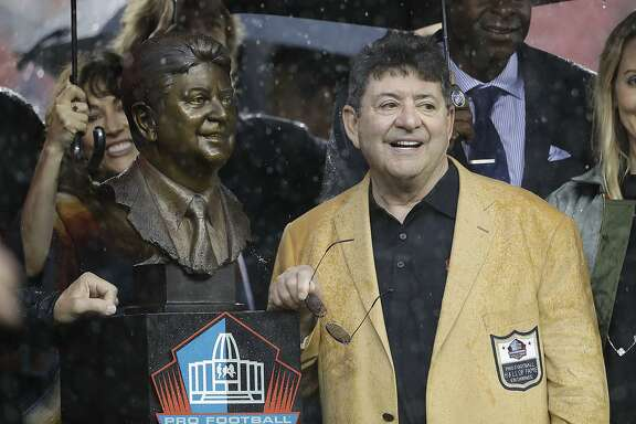 Former San Francisco 49ers owner Edward DeBartolo smiles next his hall of fame bust during a ceremony for receiving his hall of fame ring during half time of an NFL football game between the San Francisco 49ers and the New England Patriots in Santa Clara, Calif., Sunday, Nov. 20, 2016. (AP Photo/Marcio Jose Sanchez)