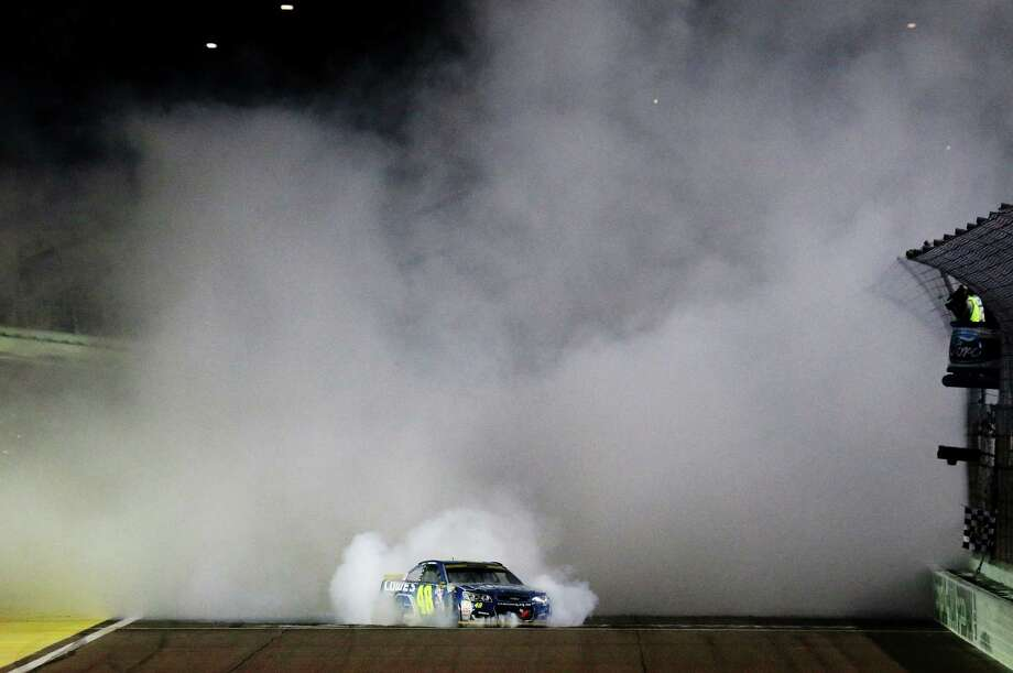 HOMESTEAD, FL - NOVEMBER 20:  Jimmie Johnson, driver of the #48 Lowe's Chevrolet, celebrates with a burnout after winning the NASCAR Sprint Cup Series Ford EcoBoost 400 and the 2016 NASCAR Sprint Cup Series Championship at Homestead-Miami Speedway on November 20, 2016 in Homestead, Florida. Johnson wins a record-tying 7th NASCAR title. Photo: Jerry Markland, Getty Images / 2016 Getty Images