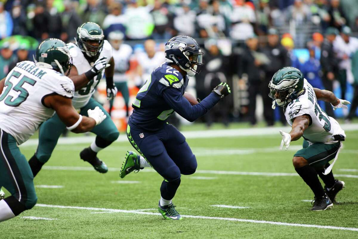 Seahawks running back C.J. Prosise maneuvers through the Eagles defense in the first quarter of the Seahawks game against the Philadelphia Eagles, Sunday, Nov. 20, 2016 at CenturyLink Field.