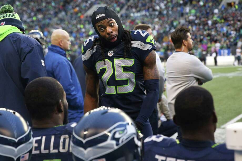 Seahawks corner back Richard Sherman talks with Seahawks safety Kam Chancellor on the side line during the third quarter of the Seahawks game against the Philadelphia Eagles, Sunday, Nov. 20, 2016 at CenturyLink Field. Photo: GENNA MARTIN, SEATTLEPI.COM / SEATTLEPI.COM
