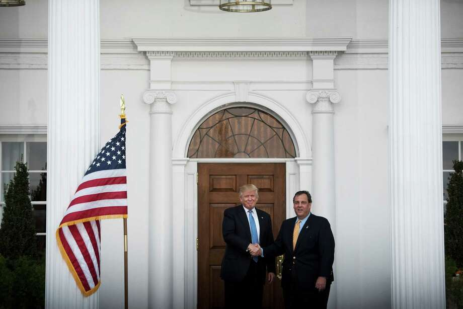 President-elect Donald Trump and New Jersey Gov. Chris Christie outside the clubhouse at Trump National Golf Club in Bedminster, N.J., where work on Trump's transition to the White House continued, Nov. 20, 2016. (Hilary Swift/The New York Times) Photo: HILARY SWIFT, STR / NYTNS