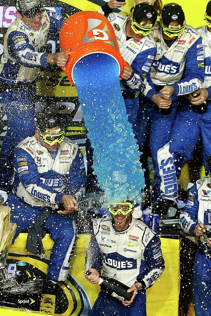 The champagne was flying and the Gatorade was flowing as Jimmie Johnson, center, celebrated with his Hendrick Motorsports team in Victory Lane.
