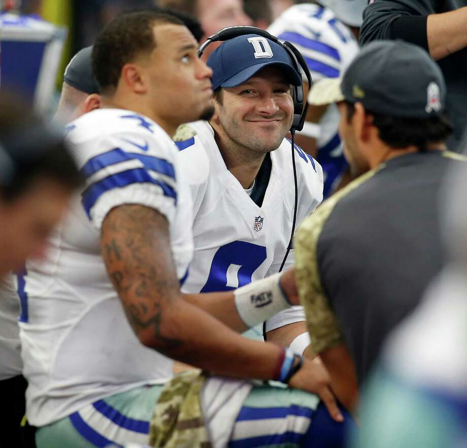 Despite being a backup for the first time in 10 years, Cowboys quarterback Tony Romo, right, is all smiles as he sits next to starter Dak Prescott on Sunday. Photo: Brad Loper, MBR / Fort Worth Star-Telegram