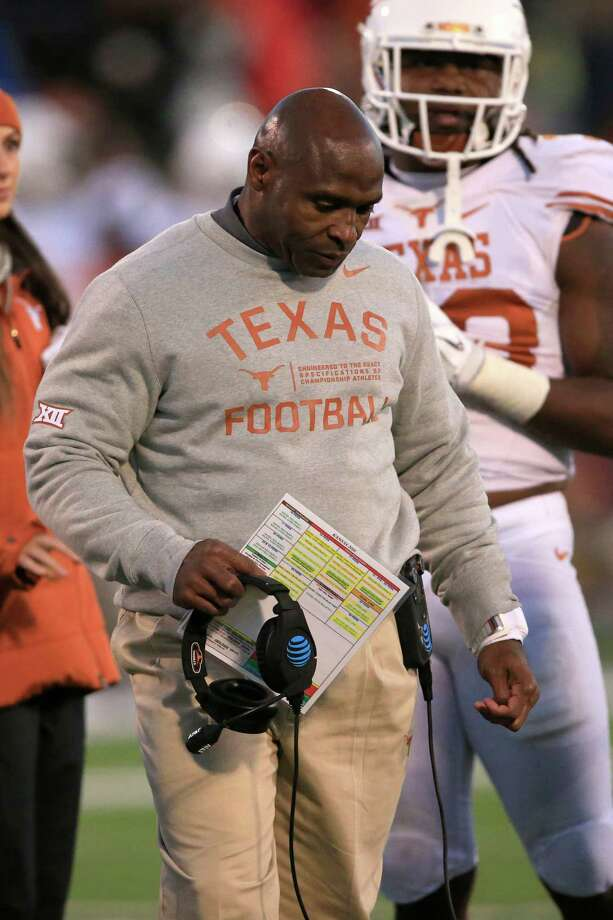It was hard for Texas coach Charlie Strong to keep his head up Saturday at Kansas, which beat the Longhorns to snap a 19-game Big 12 losing streak. Photo: Orlin Wagner, STF / Copyright 2016 The Associated Press. All rights reserved.