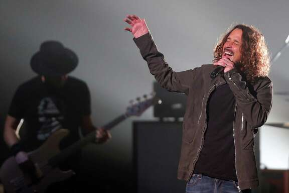 "Temple of the Dog, with lead singer Chris Cornell of Soundgarden, performs at the Paramount Theater in Seattle, Sunday, Nov. 20, 2016. Cornell formed the ""superband"" in 1990 with artists from Mother Love Bone, Soundgarden, and Pearl Jam, as a tribute to their friend and singer Andrew Wood."