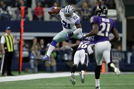 ARLINGTON, TX - NOVEMBER 20:   Ezekiel Elliott #21 of the Dallas Cowboys leaps over Tavon Young #36 of the Baltimore Ravens during the third quarter of their game at AT&T Stadium on November 20, 2016 in Arlington, Texas.  (Photo by Ronald Martinez/Getty Images) ***BESTPIX***