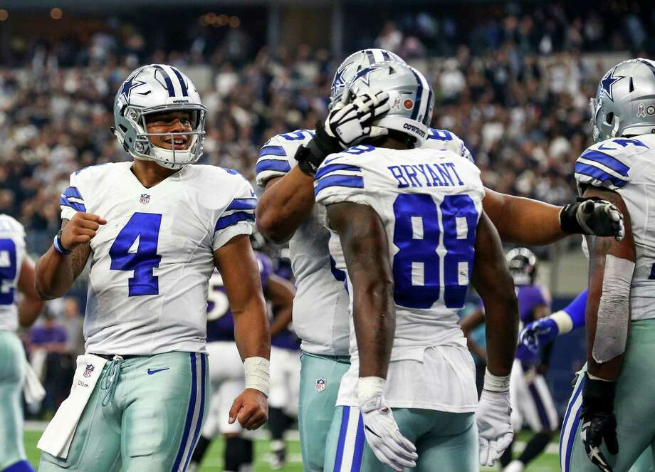 Dallas Cowboys quarterback Dak Prescott (4) and wide receiver Dez Bryant (88) celebrate a fourth quarter touchdown against the Baltimore Ravens on Sunday, Nov. 20, 2016 at AT&T Stadium in Arlington, Texas. Photo: Richard W. Rodriguez, TNS / Fort Worth Star-Telegram