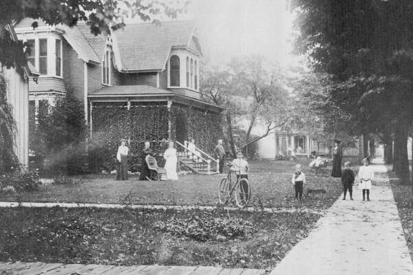 This photograph from 1904 shows the Larkin neighborhood from George Street to State. The Huyck residence barely shows in the foreground. The big house next was where the Reardons lived. The other homes on the block belonged to the Benjamin Balls, J. Neebs and T.W. Crisseys. Notice the cement sidewalk.