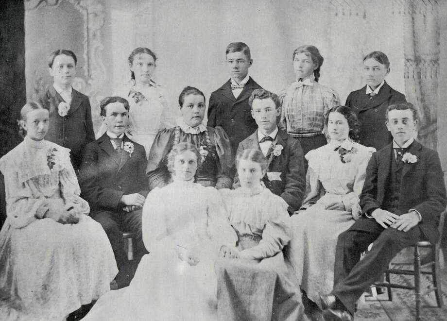 Last class of the 19th Century at Midland High numbered only 13. The school was located on Grove Street at the end of McDonald. Members of the Class of 1899 are, top row, from left, Weston Burrington, Laura Foster, Reid Richardson, Bessie (Cady) Carey and Roy Fleming. Center, Rowena Graves, Michael O'Neil, Bertha Stanford, Harry Mustard, Dessalee Ryan and Emer Oderkirk. Front, Myrtle Sayre and Myra Thompsosn. Photo: Daily News File Photo