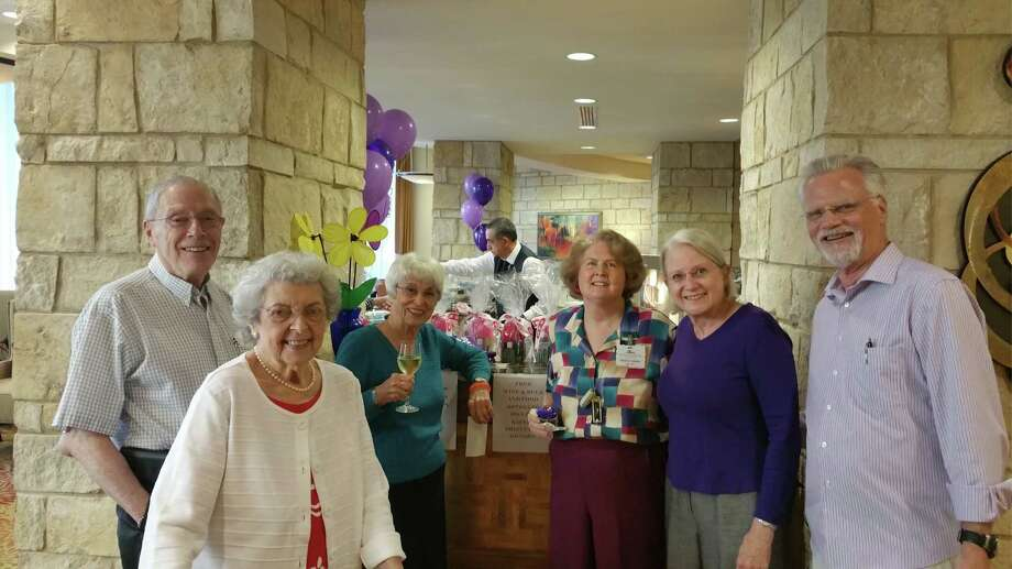 "Residents gather for a ""Purple Happy Hour"" in their newly open bar celebrating a fundraising event for the Alzheimer Association."